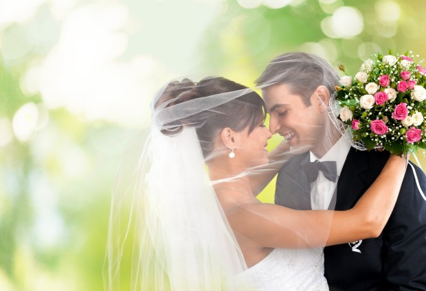 Bride and groom celebrating their wedding with the help of a personal wedding loan.