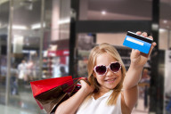 Young girl with credit card.